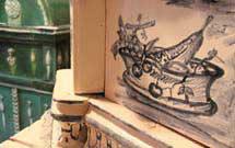 Dipindo a mano di frutta su stufa bianca