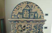 Stufa antica restaurata in una moderna abitazione, parte superiore