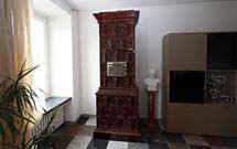 Stufa marrone verticale presso abitazione moderna' title='Stufa marrone verticale presso abitazione moderna