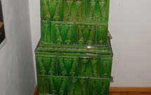 Stufa antica restaurata di colore verde 2